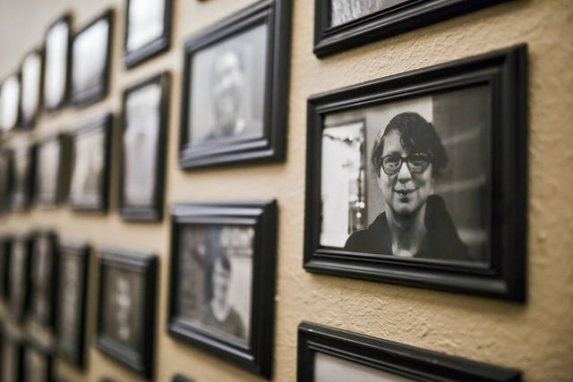 Photos of facility members line the walls at the Thunderbird Clubhouse in  Norman on Wednesday.