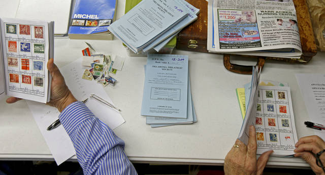 Oklahoma City Stamp Club Members Look Over Philatelic Society Books During A Meeting In