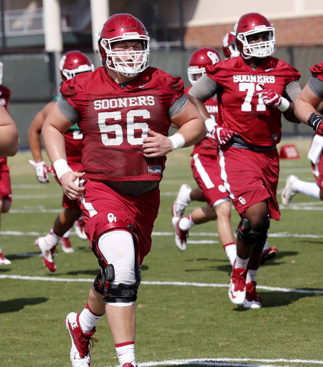 True freshman Creed Humphrey, left, practiced with the offensive line's A group during Monday's practice. [PHOTO BY STEVE SISNEY, THE OKLAHOMAN]