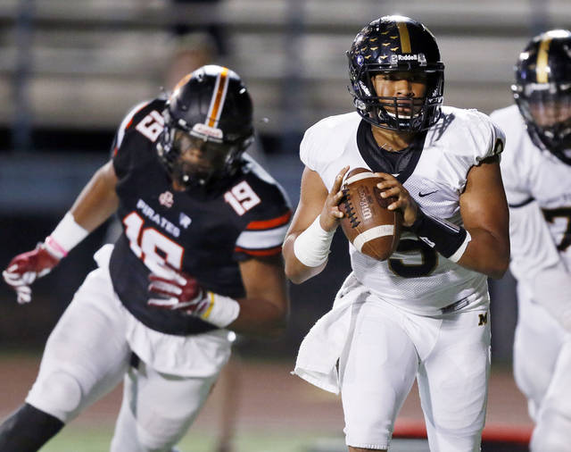 High school football: Midwest City quarterback Preston Colbert leads way past Putnam City Image