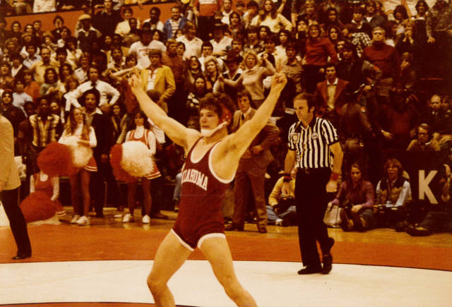 Andre Metzger celebrates a victory while wrestling for OU. [PHOTO PROVIDED]