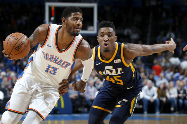 Paul George drove past Donovan Mitchell on Dec. 5 in Oklahoma City