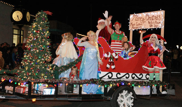 Santa Claus and friends wave to the Parade of Lights crowd from the float sponsored by & Moore kicks off holidays with parade tree lighting | News OK azcodes.com